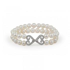 Natural white pearl bracelet with designer lock