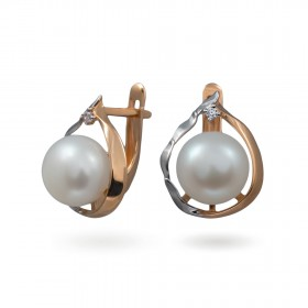 Earrings in 14 karat gold with natural pearls and cubic zirkonia