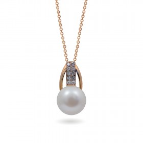 Pendant in 14 karat gold with natural pearls and cubic zirkonia